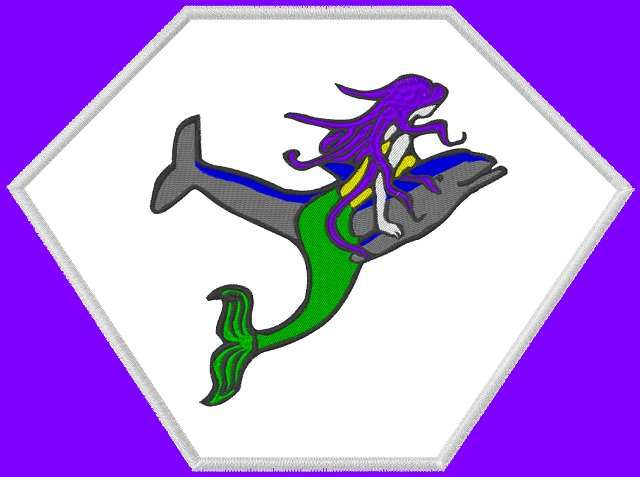 Kid size purple cape, white hexagon, with a Mermaid with purple hair on a dolphin